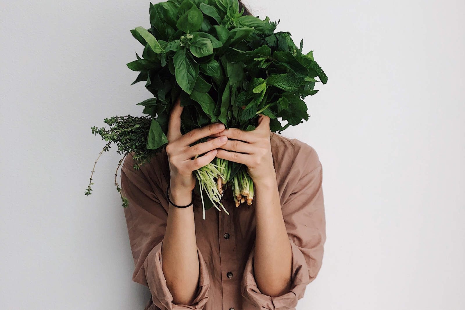Woman Holding Vegetable | What Are The Main Vegan Health Benefits (and Drawbacks)?