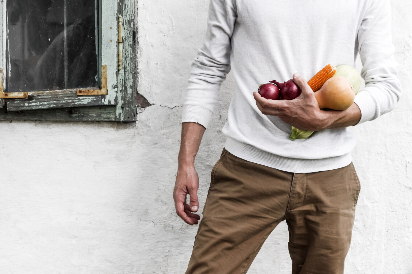 Man Holding Vegetables | 18 Popular Snack Foods That Are Actually Vegan Approved